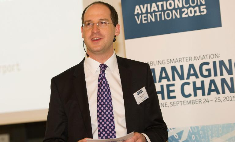 Roland Berger's Kai-Marcus Peschl speaking at the Aviation Convention in Cologne.