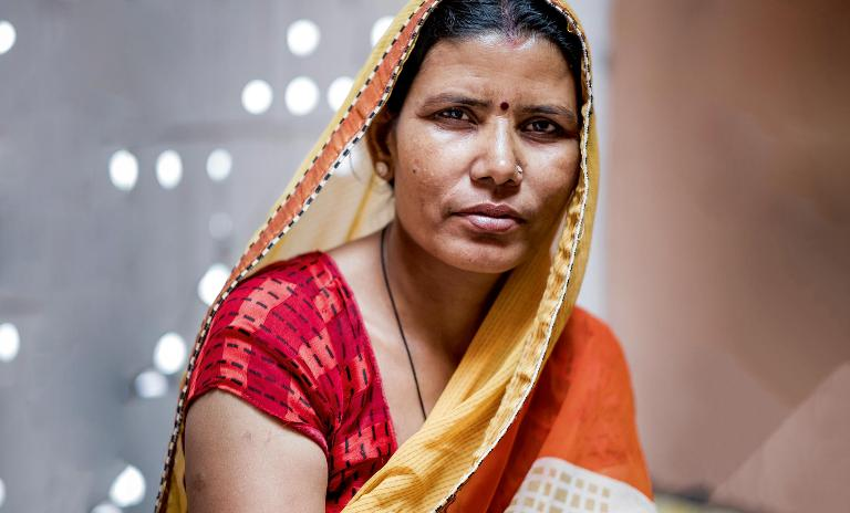 A common thread: Once struggling herself, Shanti (left) now oversees more than six looms and the 25 weavers that she can employ at a fair wage thanks to Jaipur Rugs' practices.