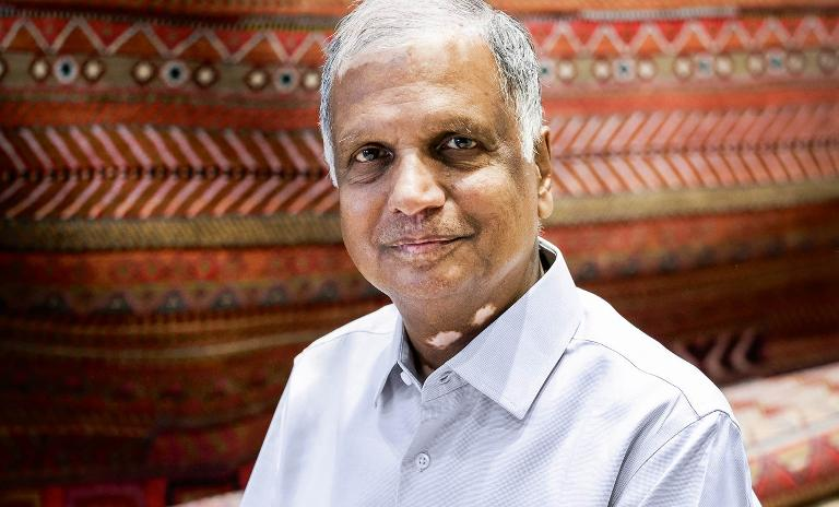 The ties that bind: Nand Kishore Chaudhary attributes his success to treating his weavers like family and focusing on their growth as much as his company's.