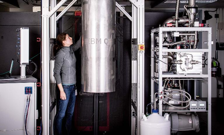 Reaching the real world: IBM Q team member Katie Pooley examines a cryostat containing a new prototype for a commercial quantum processor.