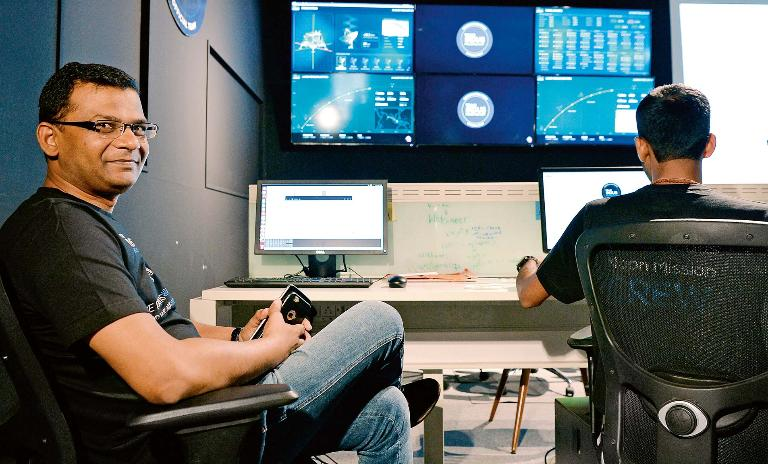 At the controls: Rahul Narayan holds a demonstration for the media at the TeamIndus lunar mission command center in October 2017.