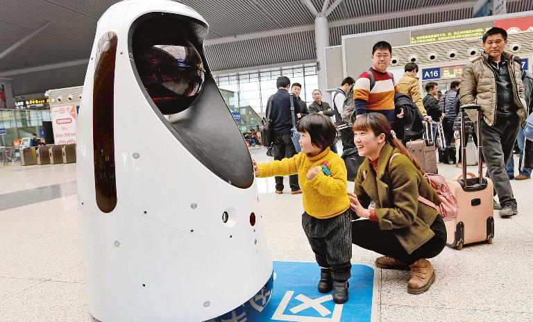 To protect and serve: The police robot at Zhengzhou East Railway Station can clean, monitor air quality, detect fire and also compare passenger faces to those of escaped criminals.