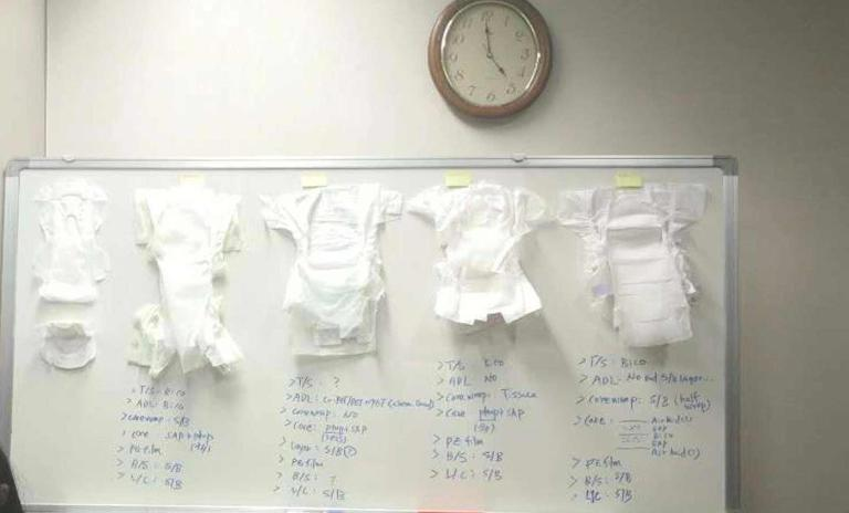 The white board with diapers and hygiene pads
