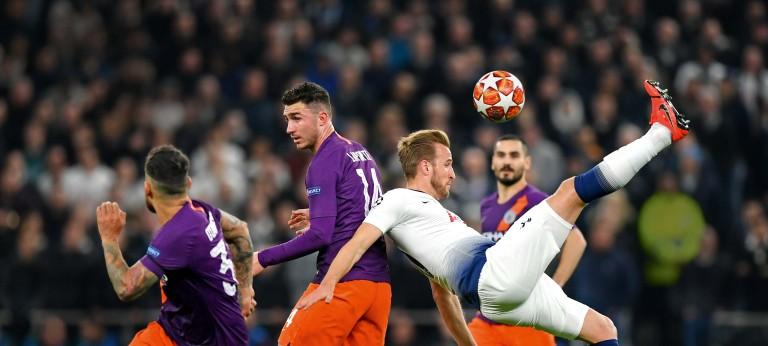 Tottenham Hotspur striker Harry Cane kicks a football over his head during match play
